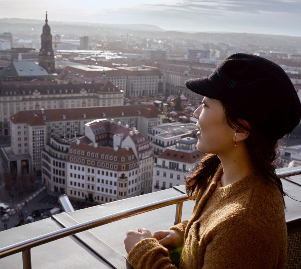 girl on top of a building in dresden