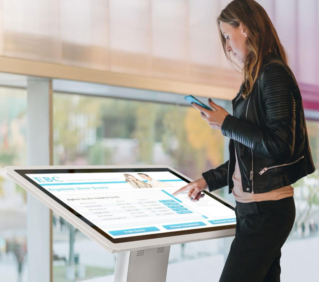 woman handling a multi touch table