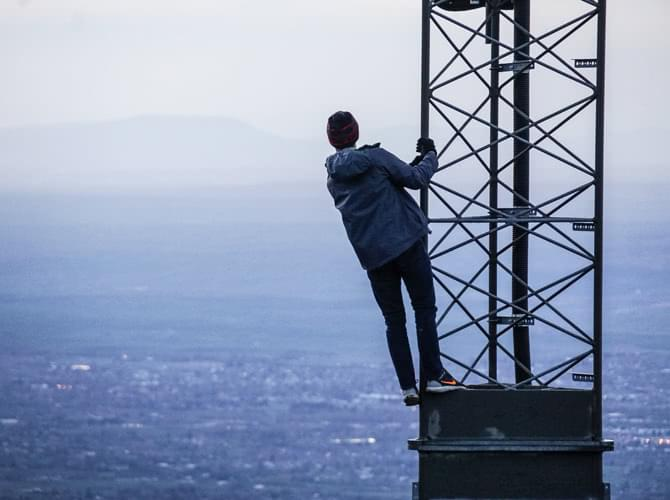 man on top of a tower