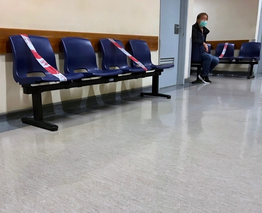 Man in Waiting Room with closed seats