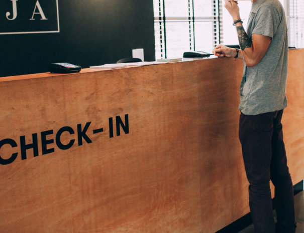 man standing in front of check in desk
